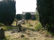 Raking up the grass