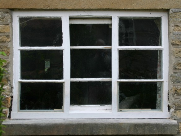 With the timber spliced in it can be traditionally jointed and the mouldings replicated. All that is left to do here is to re-point around the window using a natural lime mortar.