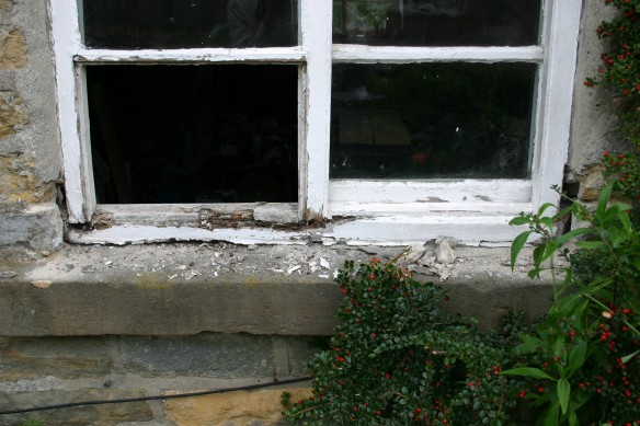 Window before repair work commences – window sills, bottom rail and lower frames are decayed.