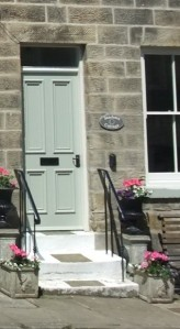 This door shows a typical bolection mould, where the moulding projects beyond the face of the frame. Copyright NYMNPA.