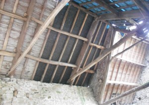 This historic truss incorporates a tie beam which has been re-used from an earlier roof structure. Copyright NYMNPA.