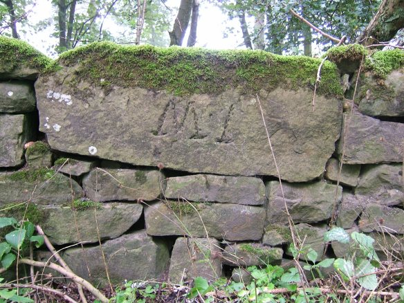 Large engraved stone within drystone wall - copyright Roy McGhie, NYMNPA.