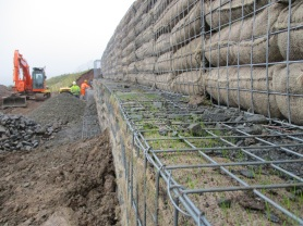 Rosedale landslip repairs autumn 2016 - grass seed germinating in bags at front of gabions. Copyright NYMNPA.