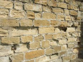 Extent of stone decay caused by inappropriate use of a cement mortar. Copyright NYMNPA.