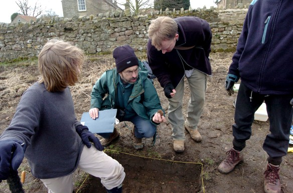 Graham at work - examining finds at an archaeological excavation - Coxwold Creative Minds Project, March 2006. Copyright - NYMNPA.