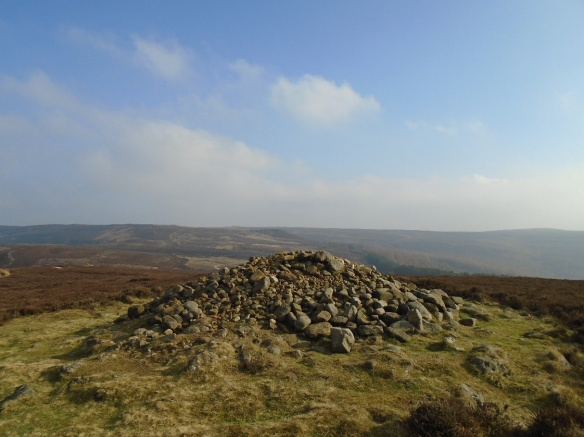 Live Moor monument after remedial work. Some loose stones have been left around the centre of the mound to protect the bare ground on the top until the vegetation can re-establish itself. Copyright Solstice Heritage.