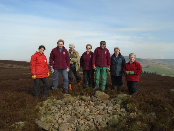 Raisdale Moor - At the end of the task, National Park volunteers and Jo next to the round barrow without the walkers cairn. Copyright NYMNPA.
