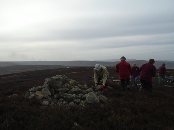 Raisdale Moor - NPA volunteers removing the walkers cairn from the scheduled barrow. Copyright NYMNPA.