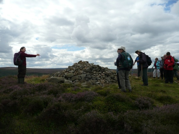 Historic Environment Volunteers Day Out 5 August 2017. Discussing monument management at a bronze age burial cairn. Copyright NYMNPA.