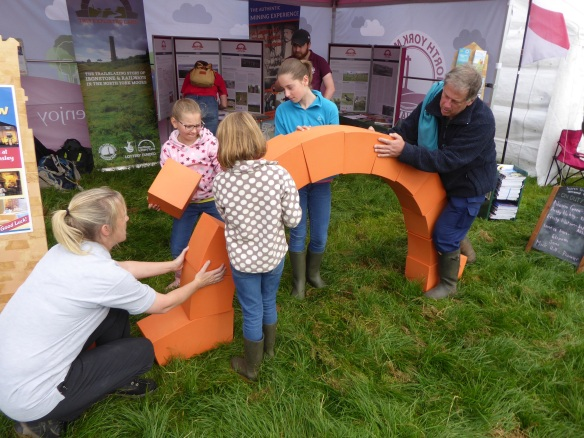 Families loved our engineering challenge to build an archway at Egton Show this year. Copyright NYMNPA.