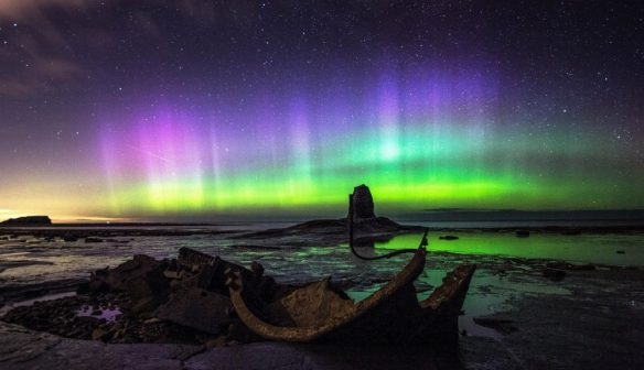(Cropped) Northern Lights at Saltwick Bay. Credit Andy Dawson Photography.