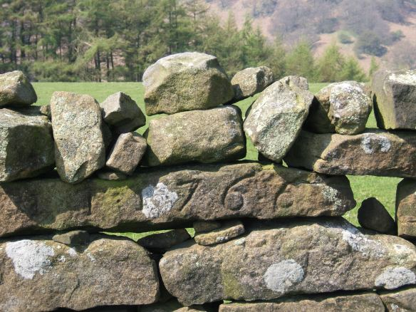 Close up of drystone wall with engraved date - copyright NYMNPA