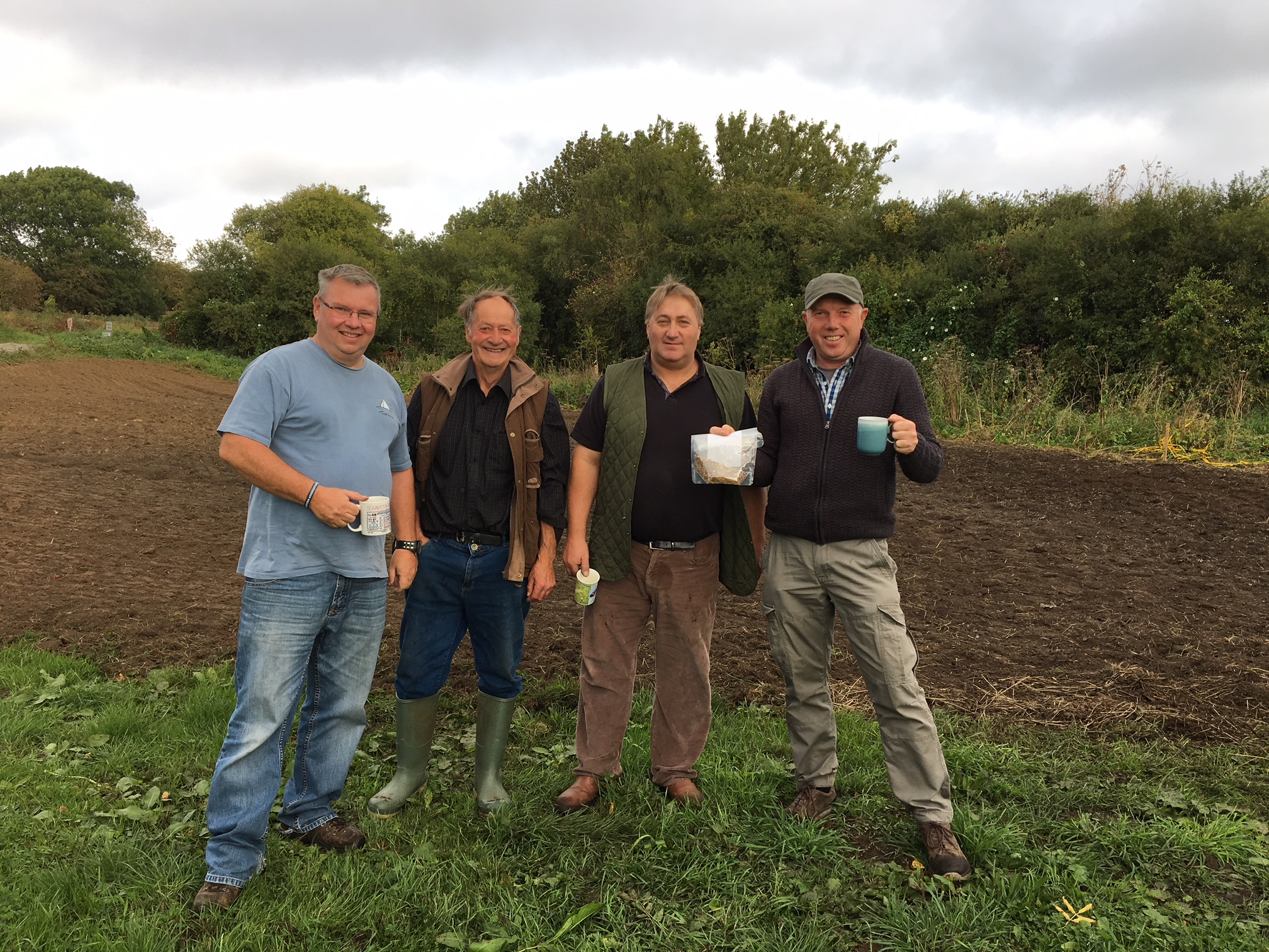 Sawdon Community Group, with Richard on the right - celebrating the first community Turtle Dove plot with a mug of tea!. Copyright NYMNPA.