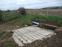 This watering point was improved by creating an area of hardstanding using concrete sleepers. The water quality will now be improved for river species and also for the farm livestock. Copyright NYMNPA.