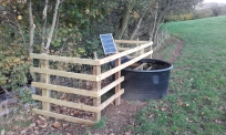 Solar water pump and trough installed. Copyright NYMNPA.