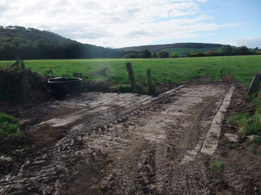 A new culvert pipe was installed in the ditch to transfer the water in the ditch under the crossing point and concrete sleepers were laid over the top of the ditch to form a hard surface which will prevent the area becoming churned up and being a source of fine sediment. Copyright NYMNPA.