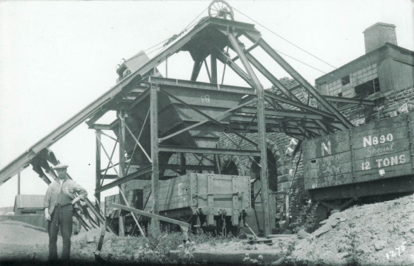 Rosedale kilns and railway wagons, a detail of the process to move the ironstone. Photograph courtesy of the Rosedale History Society Archive.