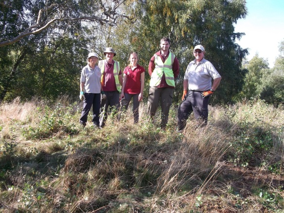 Some of the Conservation Volunteers Group after a satisfying day of clearing scrub from a bronze age round barrow (Scheduled Monument). Copyright NYMNPA.