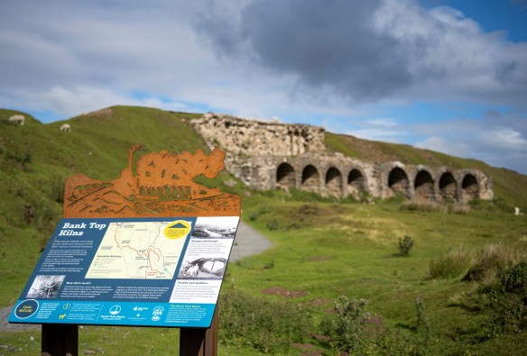 Rosedale Bank Top calcining kiln after conservation work was completed in 2019, with the new interpretation panel and Cor Ten silhouette. Copyright NYMNPA.